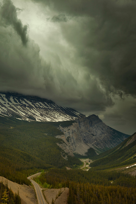 Ominous looking clouds build over a section of the Icefields Parkway in Banff National Park, Alberta, Canada.  Photo by Gus Curtis.