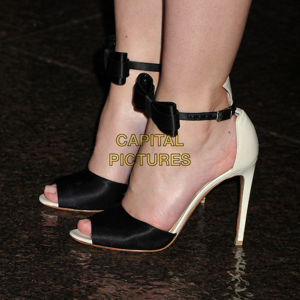Emily Blunt's shoes.CBS Films' U.S. Premiere of 'Salmon Fishing In The Yemen' held at The Directors Guild of America in West Hollywood, California, USA..March 5th, 2012.detail feet heels peep toe ankle strap black bow ribbon.CAP/ADM/BP.©Byron Purvis/AdMedia/Capital Pictures.