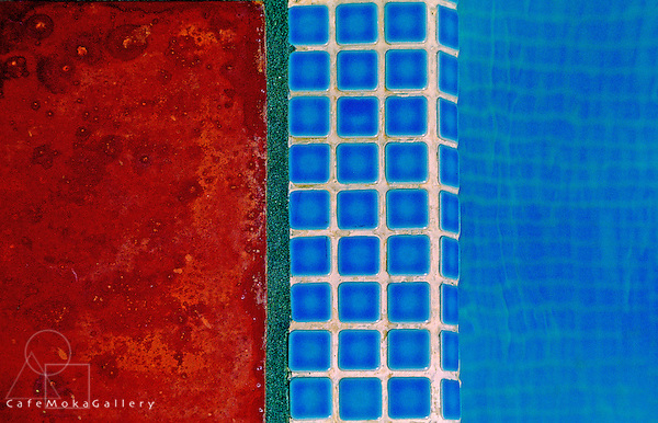Complementary colours, aqua and terracotta tiles by a swimming pool