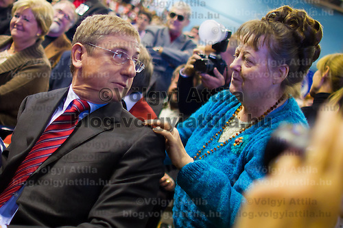 Ferenc Gyurcsany (2nd R) former prime minister of Hungary is greeted by a supporter during the Foundation of the Democratic Coallition Party in Budapest, Hungary on October 22, 2011. ATTILA VOLGYI