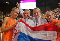 Februari 08, 2015, Apeldoorn, Omnisport, Fed Cup, Netherlands-Slovakia, The winning Dutch team ,.tlrl:  Arantxa Rus, Michaella Krajicek, Kiki Bertens and Richel Hogenkamp  <br /> Photo: Tennisimages/Henk Koster