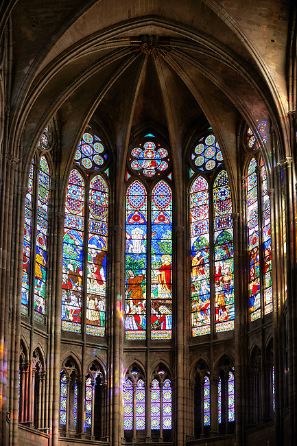Medieval Gothic stained glass window showing  scenes from the Martyrdom of Saint Denis over the high altar. The Gothic Cathedral Basilica of Saint Denis ( Basilique Saint-Denis ) Paris, France. A UNESCO World Heritage Site.