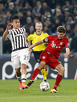 Calcio, andata degli ottavi di finale di Champions League: Juventus vs Bayern Monaco. Torino, Juventus Stadium, 23 febbraio 2016. <br /> Bayern&rsquo;s Thomas Mueller, right, is challenged by Juventus&rsquo; Paulo Dybala during the Champions League round of 16 first leg soccer match between Juventus and Bayern at Turin's Juventus Stadium, 23 February 2016.<br /> UPDATE IMAGES PRESS/Isabella Bonotto
