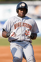 Michael Burgess (30) of the Hagerstown Suns pulls into third base with a stand up triple at Fieldcrest Cannon Stadium in Kannapolis, NC, Sunday May 25, 2008.
