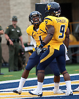 WVU wide receiver Tavon Austin (left) celebrates his touchdown with Jock Sanders. The WVU Mountaineers defeated the East Carolina Pirates 35-20 at Mountaineer Field at Milan Puskar Stadium, Morgantown, West Virginia on September 12, 2009.