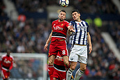 30th September 2017, The Hawthorns, West Bromwich, England; EPL Premier League football, West Bromwich Albion versus Watford; Gareth Barry of West Bromwich Albion and Tom Cleverley of Watford jump for a header