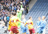 Stephen  Craigan (hidden) heads the ball over Peter Enckelman for the opening goal