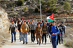 "Palestinians take part in the walking tour titled ""eyes Tavouh"" in the village of Tavouh in the northwest the West bank city of Hebron on the December 31, 2016. Photo by Wisam Hashlamoun"