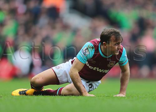 27.02.2016. Boleyn Ground, London, England. Barclays Premier League. West Ham versus Sunderland. West Ham United Captain Mark Noble goes down with an ankle injury