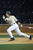 Christian Long (19) of the Wake Forest Demon Deacons follows through on his swing against the Davidson Wildcats at David F. Couch Ballpark on February 28, 2017 in Winston-Salem, North Carolina.  The Demon Deacons defeated the Wildcats 13-5.  (Brian Westerholt/Four Seam Images)