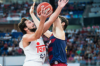 Real Madrid's player Sergio Llull and FC Barcelona Lassa's player Ante Tomic during the match of the semifinals of Supercopa of La Liga Endesa Madrid. September 23, Spain. 2016. (ALTERPHOTOS/BorjaB.Hojas)