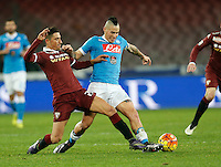 Giuseppe Vives fight for the ball withNapoli's Marek Hamsik  during the  italian serie a soccer match,between SSC Napoli and Torino      at  the San  Paolo   stadium in Naples  Italy , January 07, 2016