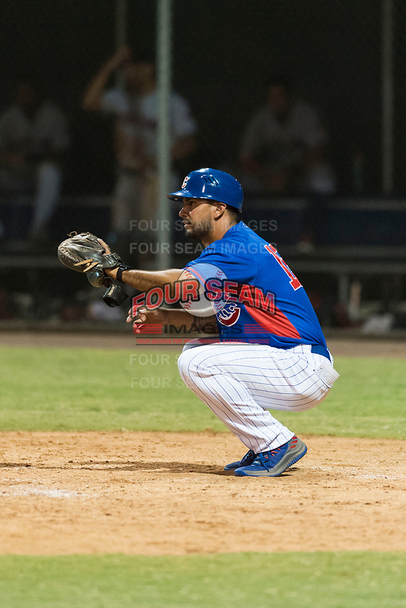 AZL Cubs 2 manager Jonathan Mota (15) warms up his pitcher between innings of an Arizona League game against the AZL Indians 2 at Sloan Park on August 2, 2018 in Mesa, Arizona. The AZL Indians 2 defeated the AZL Cubs 2 by a score of 9-8. (Zachary Lucy/Four Seam Images)