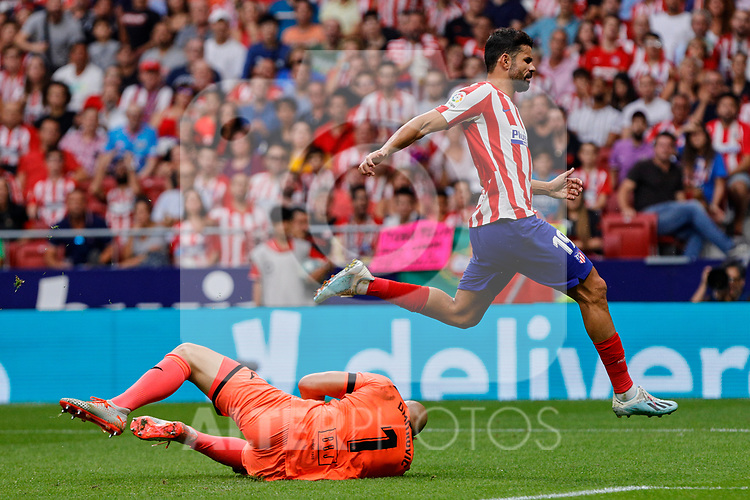 Diego Costa of Atletico de Madrid and Marko Dmitrovic of SD Eibar in action during La Liga match between Atletico de Madrid and SD Eibar at Wanda Metropolitano Stadium in Madrid, Spain.September 01, 2019. (ALTERPHOTOS/A. Perez Meca)