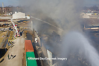 63818-02316 Firefighters extinguishing warehouse fire using aerial ladder truck viewed from top of ladder, Salem, IL