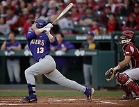 NWA Democrat-Gazette/ANDY SHUPE<br /> LSU catcher Saul Garza follows through Friday, May 10, 2019, after hitting a 2-run home run during the second inning against Arkansas at Baum-Walker Stadium in Fayetteville. Visit nwadg.com/photos to see more photographs from the game.