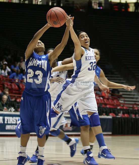 Hampton's Jericka Jenkins and UK Hoops' freshman guard Kastine Evan fight over a loose ballin overtime of UK Hoops' first round NCAA game against Hampton in The Pit in Albuquerque, New Mexico, 3/19/11. Photo by Brandon Goodwin | Staff.