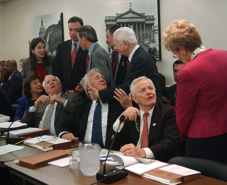 11/16/04.FOREIGN OPERATIONS APPROPRIATIONS CONFERENCE--Nita M. Lowey, D-N.Y., Jim Kolbe, R-Ariz., House Appropriations Chairman C.W. Bill Young, R-Fla., Senate Appropriations ranking Democrat Robert C. Byrd, D-W.Va., Joe Knollenberg, R-Mich., and Marcy Kaptur, D-Ohio, and aides talk before the joint House-Senate conference on foreign operations appropriations, which will be the vehicle for the larger package as appropriators continued Wednesday to hash out the final details of an omnibus fiscal 2005 appropriations package that Republican leaders plan to clear for the president late this week..CONGRESSIONAL QUARTERLY PHOTO BY SCOTT J. FERRELL