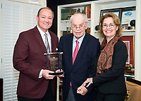 Mississippi State President Mark E. Keenum presents the National Alumnus of the Year award to Dr. R.L. Qualls of Little Rock, Arkansas, and his wife, Nancy. Qualls, a two-time graduate of MSU, was among alumni recognized Friday [Feb. 2] at the MSU Alumni Association's 2018 awards banquet.<br />