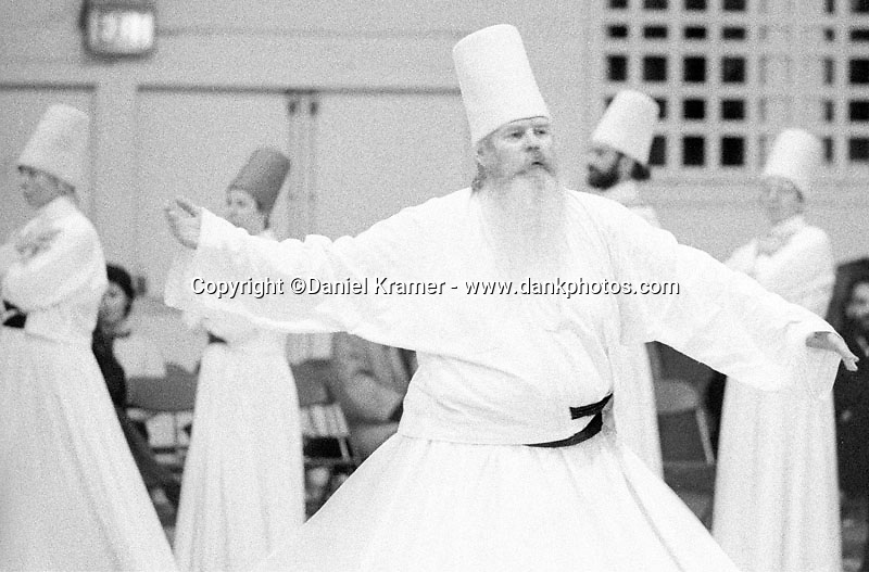 Rashid Patch dances in the Sema.<br /> The Whirling Dervishes trace their origin to the 13th century Ottoman Empire. The Dervishes, also known as the Mevlevi Order, are Sufis, a spiritual offshoot of Islam. In 1972, Jelaluddin Loras, Sheik of the Mevlevi Order of America, brought the religion from Turkey to the United States. On December 17, Whirling Dervishes across the world celebrate the birth of Jelaluddin Mevlana Rumi, a mystic poet, who founded the Mevlevi Order. I am the first photographer allowed to document this group.