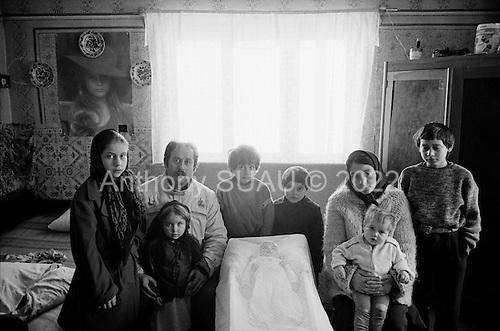 Mogosesti, Maramures <br /> Romania<br /> January 2, 1992<br /> <br /> A family prepares to bury their deceased baby.