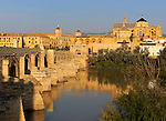Roman bridge spanning river Rio Guadalquivir leading to the cathedral buildings, Cordoba, Spain