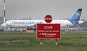 File Photo dated 12/07/11 showing a Thomas Cook jet at East Midlands Airport.<br />