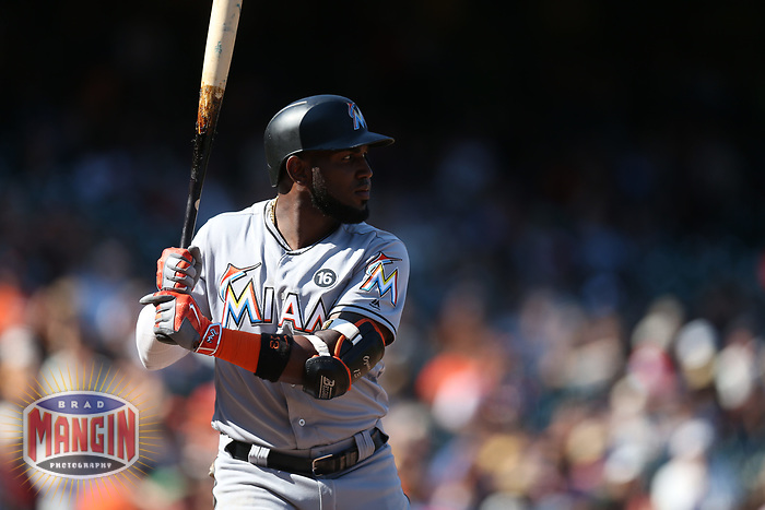 SAN FRANCISCO, CA - JULY 9:  Marcell Ozuna #13 of the Miami Marlins bats against the San Francisco Giants during the game at AT&T Park on Sunday, July 9, 2017 in San Francisco, California. (Photo by Brad Mangin)