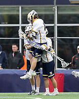 Foxborough, Massachusetts - May 27, 2018: NCAA Division II tournament final. Merrimack College (white/blue) defeated Saint Leo University (green/white), 23-6, at Gillette Stadium.<br /> Goal celebration.