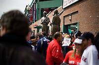 "Opening day crowds congregate around a statue entitled ""Teammates"" by Antonio Tobias Mendez featuring the likenesses Ted Williams, Johnny Pesky, Bobby Doerr and Dom DiMaggio, stands outside of Gate B at Fenway Park in Boston, Massachusetts, USA."