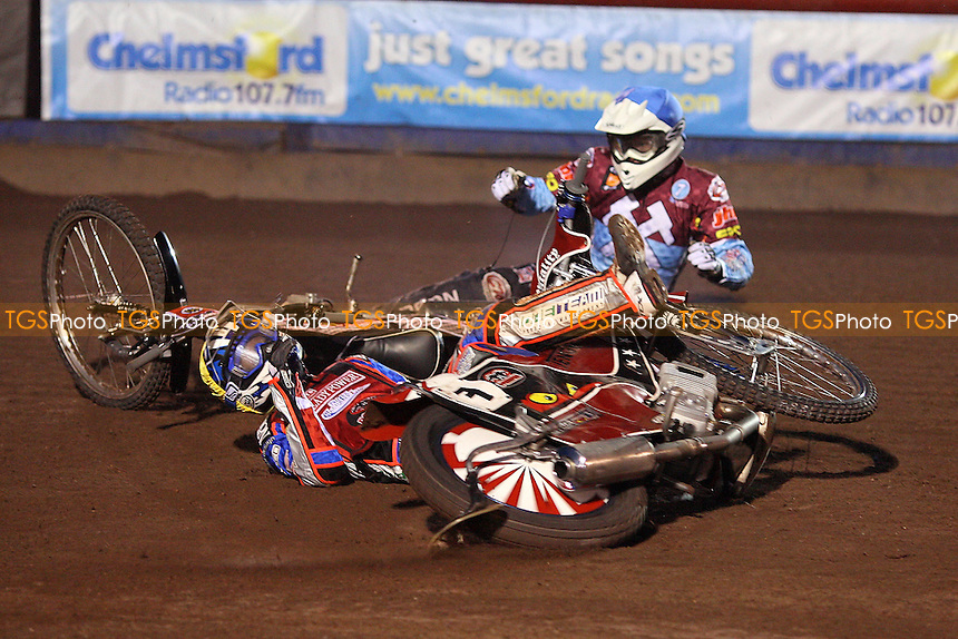 Heat 2: Rene Bach (yellow) and Stuart Robson (blue) crash out - Lakeside Hammers vs Peterborough Panthers - Sky Sports Elite League Speedway at Arena Essex Raceway, Thurrock - 03/04/09 - MANDATORY CREDIT: Gavin Ellis/TGSPHOTO - Self billing applies where appropriate - 0845 094 6026 - contact@tgsphoto.co.uk - NO UNPAID USE.