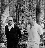 Prime Minister Menachem Begin, left, and National Security Advisor Zbigniew Brzezinski, right, talk as they walk down a path at Camp David, the presidential retreat near Thurmont, Maryland prior to their meeting on Tuesday, September 12, 1978..Credit: White House via CNP