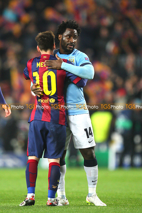 Lionel Messi of FC Barcelona and Wilfried Bony of Manchester City √ - FC Barcelona vs Manchester City - European Champions League Round of Sixteen Football at the Camp Nou Stadium on  18/03/15 - MANDATORY CREDIT: Dave Simpson/TGSPHOTO - Self billing applies where appropriate - 0845 094 6026 - contact@tgsphoto.co.uk - NO UNPAID USE
