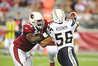 Aug. 22, 2009; Glendale, AZ, USA; San Diego Chargers linebacker (56) Shawne Merriman battles against Arizona Cardinals tackle (69) Mike Gandy during a preseason game at University of Phoenix Stadium. Mandatory Credit: Mark J. Rebilas-