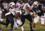 Nevada defender Salesa Faraimo (97) tackles Boise State's Jay Ajayi (27) during the first half of an NCAA college football game in Reno, Nev., on Saturday, Oct. 4, 2014. Boise State's Mario Yakoo (66) and Nevada's Jordan Dobrich are at right. Boise State won 51-46. (AP Photo/Cathleen Allison)