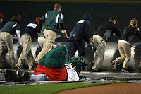June 17th 2008:  Mascot Lou E. Loon from the Great Lakes Loons, Class-A affiliate of the Los Angeles Dodgers, falls while helping with the tarp during the Midwest League All-Star Game at Dow Diamond in Midland, MI.  Photo by:  Mike Janes/Four Seam Images