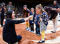 Young CAL fan is pictured growls at the microphone during Bear Growl contest during the game against Stanford at Haas Pavilion in Berkeley, California on February 5th, 2014.  Stanford defeated California, 80-69.