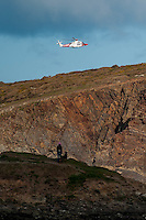 "Friday  29 April 2016<br /> Pictured: A coastguard helicopter during the search <br /> <br /> Re: Two fishermen who went missing after a boat sank in Pembrokeshire went overboard while lobster pots were being thrown into the sea.<br /> Gareth Willington, 59, from Carew, died after his boat The Harvester sank off St David's Head on 28 April.<br /> The body of his son, Daniel, 32, has never been found.<br /> Gareth Willington was not wearing a lifejacket when he was found, a report by the Marine Accident Investigation Branch said.<br /> The investigation found the pair were lobster fishing near Ramsay Island when Daniel Willington may have become entangled in ropes on the deck.<br /> His father may have tried to help him before both men went into the water ""in quick succession"", it said."