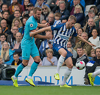 Tottenham Hotspur's Harry Kane (left) battles with Brighton & Hove Albion's Adam Webster (right) <br /> <br /> Photographer David Horton/CameraSport<br /> <br /> The Premier League - Brighton and Hove Albion v Tottenham Hotspur - Saturday 5th October 2019 - The Amex Stadium - Brighton<br /> <br /> World Copyright © 2019 CameraSport. All rights reserved. 43 Linden Ave. Countesthorpe. Leicester. England. LE8 5PG - Tel: +44 (0) 116 277 4147 - admin@camerasport.com - www.camerasport.com