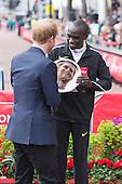 London, UK. 24 April 2016. Prince Harry with the winner of the men's race Eliud Kipchoge (KEN). The 2016 Virgin Money London Marathon finishes at the Mall, London, United Kingdom.