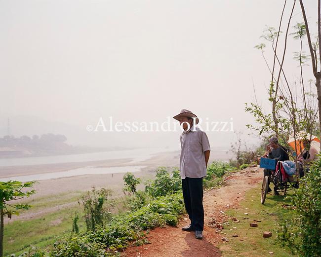Man standing along the river Mekong