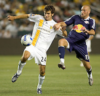 LA Galaxy DEF Nathan Sturgis (24) battles New York Red Bulls FWD Clint Mathis (13) for a loose ball. The LA Galaxy defeated the New York Red Bulls 3-1 in OT during a US Open Cup qualifier at the Home Depot Center in Carson, California, May 8, 2007.