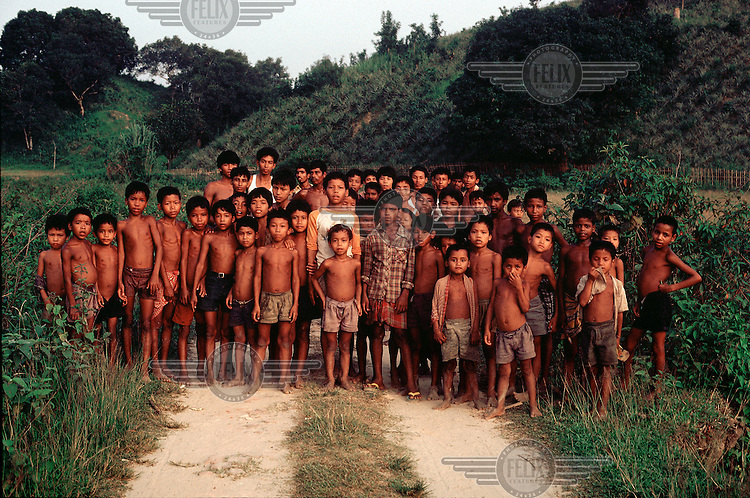 BANGLADESH : Tripra (or Tripura) children in the Srimangal region. The Tipra are a tibeto burmese people and dominant in the neighbouring Indian state of Tripura..In the background pinaapple plantations. Sylhet Province.