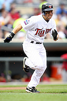 April 2, 2010: Nick Punto of the Minnesota Twins in the first professional baseball game played at the Twins new home, Target Field. Photo by: Chris Proctor/Four Seam Images