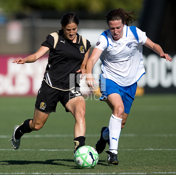 SANTA CLARA, CA--Tina DiMartino battles Kelly Shmedes during the 1-0 loss to the Boston Breakers.  Sunday, July 19, 2009.