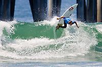 South African Brandon Jackson hits the lip during round of 96 of the 2010 US Open of Surfing in Huntington Beach, California on August 4, 2010.