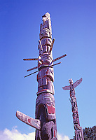 Kwakwaka'wakw (Kwakiutl) Memorial Totem Poles, on Namgis Burial Grounds, Alert Bay, Cormorant Island, BC, British Columbia, Canada - First Totem Pole: Kolus sits atop Cedar Man, above Sun Figure and Killer Whale