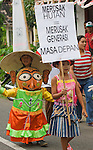 """Kids march at Dayurejo conservation carnival. Sign reads """"Destroying the forest destroys the next generation"""""""