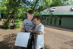 Children from Deri View Primary School visiting Welsh Water Education Centre in Cilfynydd..Pupils Kirk Green & Kallum Dutson taking part in an orienteering lesson..28.05.12.©Steve Pope