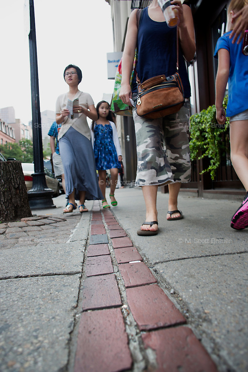A red line marks the Freedom Trail, which passes the Paul Rever House, the Old North Church, and other historical sites in the North End and elsewhere in Boston, Massachusetts, USA.